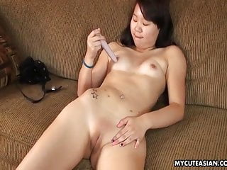 Smooth wet cunt Smooth shaven asian babe toy fucking her wet cunt
