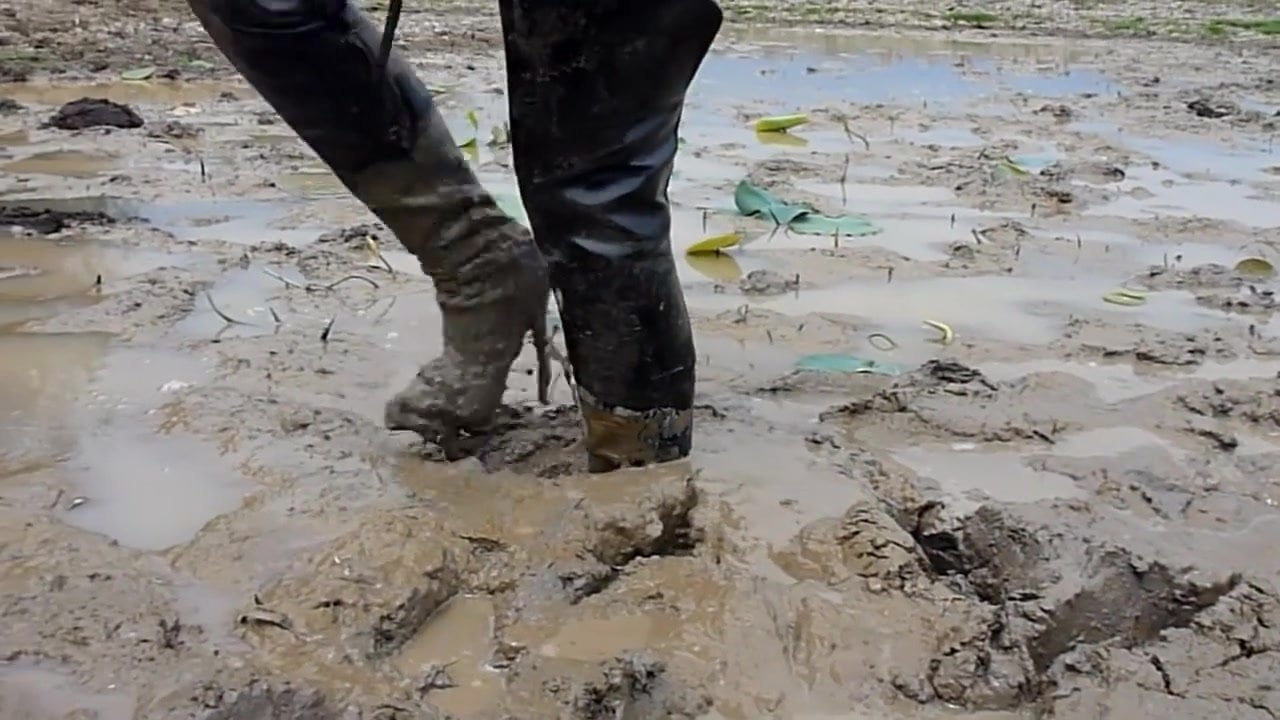 Two thai in thigh boots swim in mud!!!