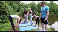 Girls and a boy do yoga outdoor