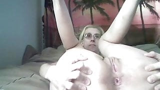 Granny with saggy tits showing and playing with her ass