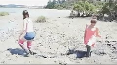 Two girls in thigh boots in very deep mud!!!