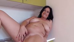 Chubby mature in kitchen