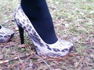 L ladies mature Lady l walking with leopard high heels.