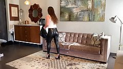 Brunette w tight leather leggings showing her ass!