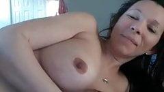 Milf with big but bad boob job plays
