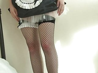 Transvestite maid spanking Brunette wears frilly, seductive maids uniform.. ooo spank me