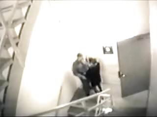Security camera porn - Blowjob on stairs recorded by a security camera