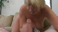Short haired blondy slurps his cock