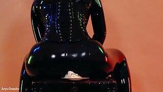 Domme Arya Grander MILF teasing in latex rubber catsuit
