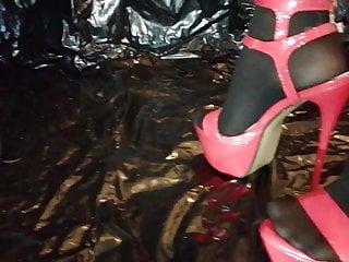 Sexy high heels crush Lady l crush umbrella with sexy red high heels.