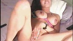 Busty Latina plays with her dildo
