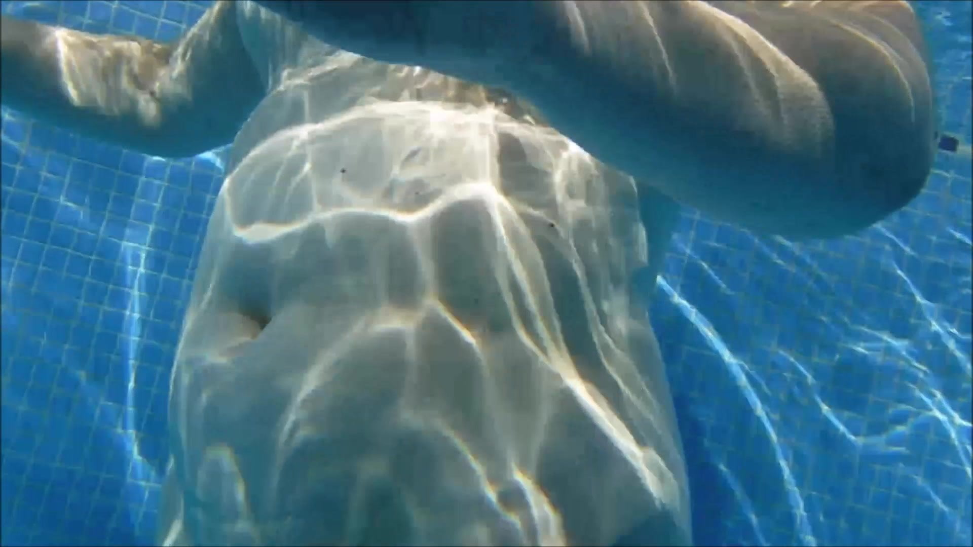 Woman floating in the swimming pool in cinemagraph stock photo