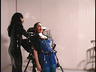 In latex lesbian toying Cutie in latex suit plays with slut