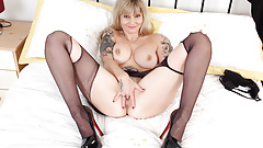 British milf Kat shows off her curvy mature body