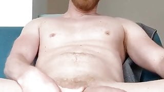 Rubbing a load out of a big hard cock