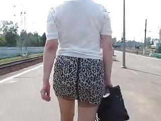 Asian girl in miniskirt Girl in miniskirt and stockings going on a train station