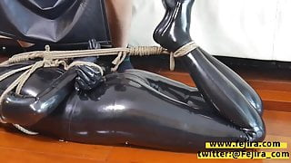 Fejira com Bondage and gagging in latex bodysuit
