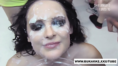 Smokey eyed girl gets painted white with cum - bukkake.xxx