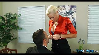 Blonde with huge Tits at work
