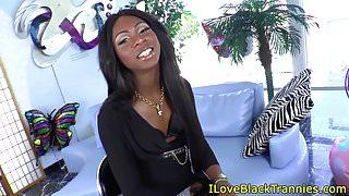 Stockinged black tgirl tugging her hung cock