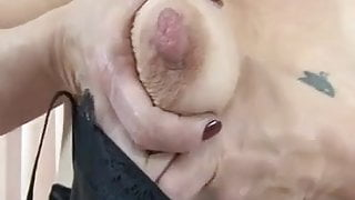 Mature with saggy tits showing her very huge nipples