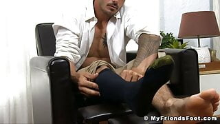 Suited athletic jock Danny shows off his feet and toes solo