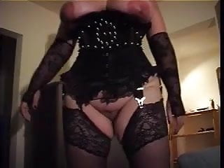 Stock bdsm Slave with big tits in black corset and nylon stockings