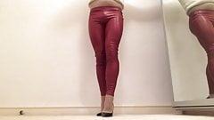 Red PVC shiny leggings .