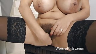 Busty brunette babe jills her hairy pussy to soaking orgasm
