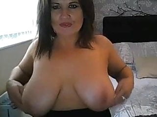Sexy milf tease - Sexy milf teases and squeezes natural pair
