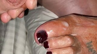 Sniffing her toes and cumming on them