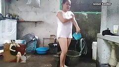 A woman takes a shower