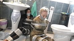 Two Girls in Catsuit Duct Taped and Gagged