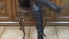 Putting on thigh high stilleto boots