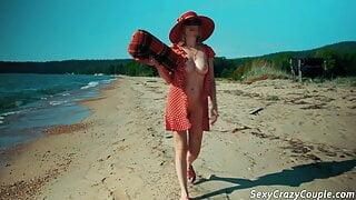 Tiffany walks naked on a sandy beach and fucks with boyfrend
