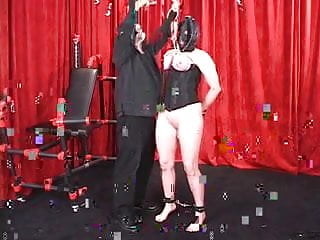 So fetish in paris - Corseted shackled woman in leather hood gets tits bound so they become red