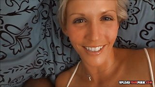 Pretty blonde fools around with a dick