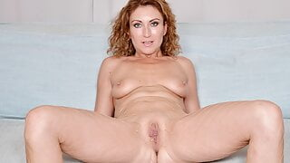 Euro milf Julia pokes her pussy with fingers