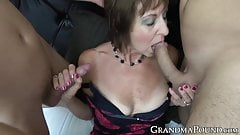 Granny in sexy lingerie spit roasted by hung young studs