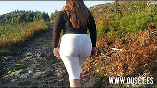 Beautiful woman with a big ass fucks in the mountains