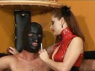 Cigarette burn porn Sexy dominatrix in red dress burns slave with smoking cigarette in dungeon