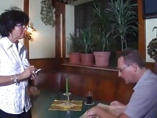 Adult older organization serving Sexy older waitress serves a customer