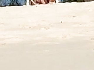 Girls pissing at the beach Spying on friend pussy on the beach...