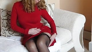Nice looking broad models her little red number.