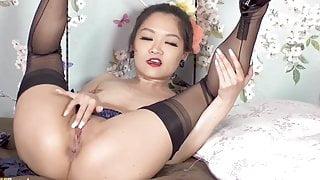Petite Asian spreads her perfect nylon legs