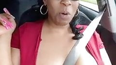 Solo ebony Desiree Desire flashes her tits while driving