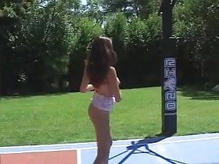Naked girls have a facesitting competition Young girls get naked and grope each other on outdoor basketball court