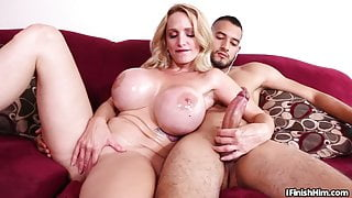 Huge tit milf masseuse tugging dick on couch