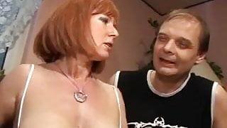 German Mature redhead with big tits