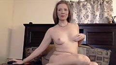 Erotic mature goddess Robin with sexy smile masturbates and